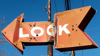 Metal Look sign pointing left