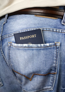 Passport in the back pocket of a pair of men's jeans