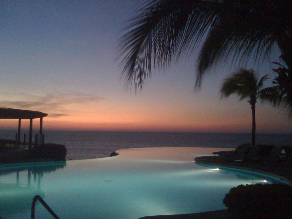 Infinity pool in Punta Mita, Mexico overlooking the ocean during sunset
